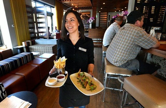 """""""Waitress Marissa Pier, of Antioch, carries appetizers to a table at the Sunol Ridge Restaurant & Bar in Walnut Creek, Calif., on Wednesday, Aug. 27, 2014. (Doug Duran/Bay Area News Group)"""""""